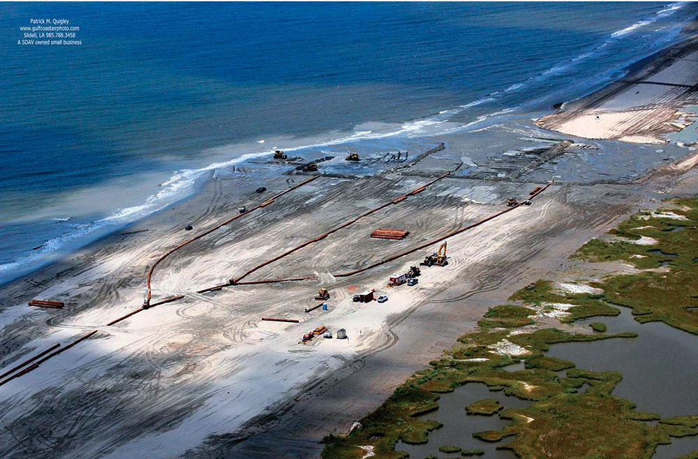 The continued deterioration of Caminada headland threatens thousands of acres of wetland habitat, as well as critical infrastructure. The project creates 300 acres of back barrier marsh and nourishes 130 acres of emergent marsh behind the Caminada beach using material dredged from the Gulf of Mexico. Photo: Patrick M. Quigley, Gulf Coast Air Photo