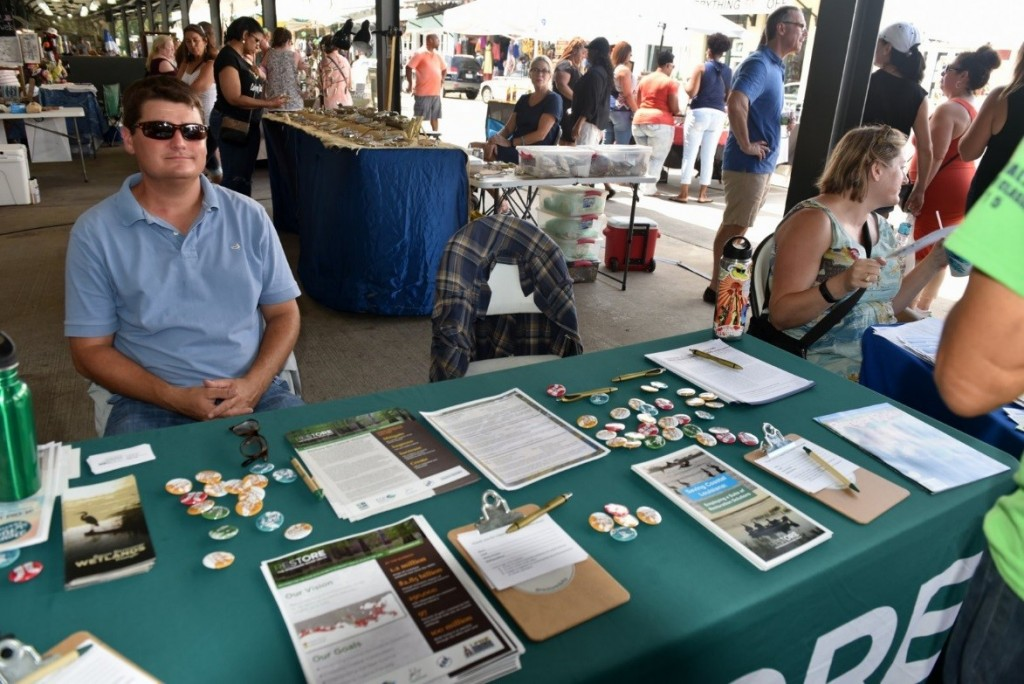 Richie Blink tabling for Restore the Mississippi River Delta at the French Market