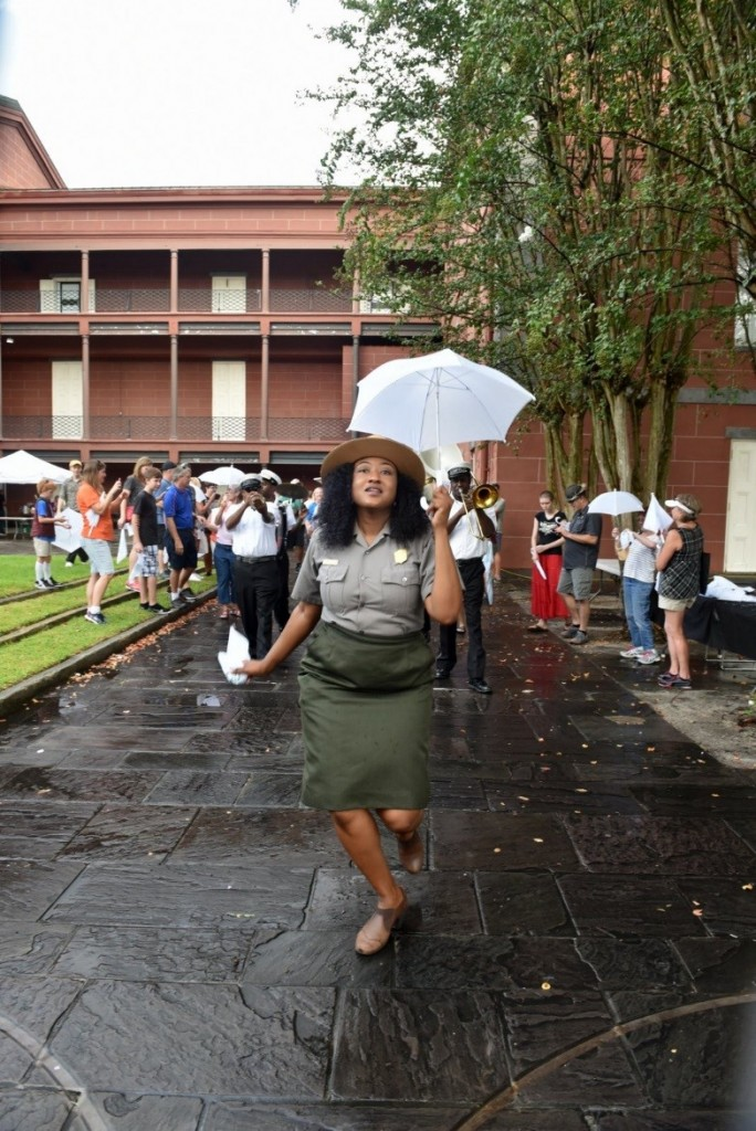 Chandra Teddleton leads the Second Line with Kinfolk Brass Band from the Old U.S. Mint to the Mississippi River (Photo courtesy of Kim Welsh)